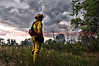 Cimarron Hills Fire Department's Lt. Matt Rasdall doing a size-up on a wildland fire with fast moving storm in the background. See this location on Google Maps at: http://goo.gl/maps/5yiO